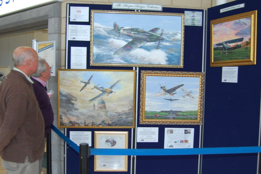 Visitors enjoying the New  Exhibition by Artist Steve Harper at the RAF museum Cosford