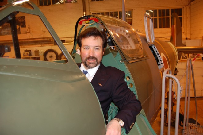 Artist Steve Harper the Honorary Patron of Shuttleworth in the beautifully restored  cockpit of the Mk 5 c Spitfire  at Shuttleworth