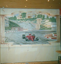 This stunning wall mural of a F1 car on full throtle brings the scene of the Monaco GP to life