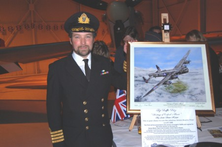 Artist Steve Harper with the Lincoln Bomber  painting