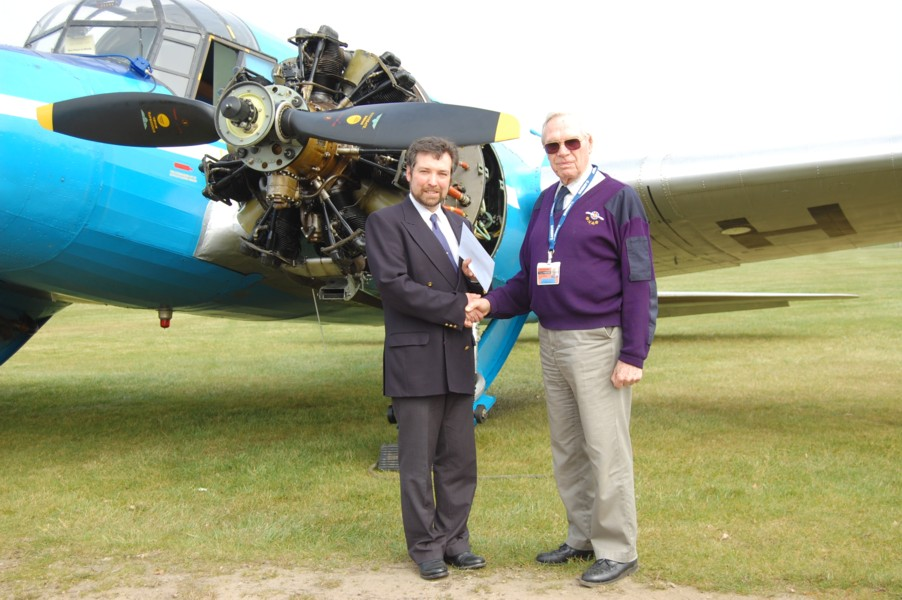 Steve Harper receiving his  Honorary Life Membership of the Shuttleworth Veteran Aeroplane Society  Ken Cox OBE